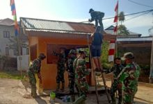 Photo of Selain Jalan, Satgas TMMD Kerinci Juga Rehab Pos Kamling