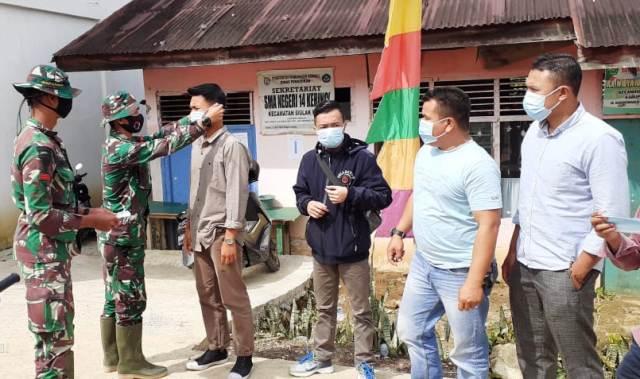 Photo of TMMD Bagi-bagi Masker Untuk Warga Sungai Langkap